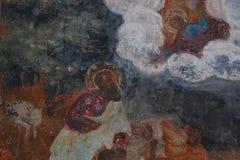 Fresko in einem alten Tempel, der Heilige darstellt Stockbilder
