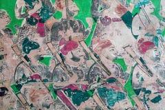 Fresko mit Kriegersmännern und -gewehren auf der Wand des historischen indischen Palastes Lizenzfreie Stockfotografie