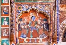 Fresko mit Krishna und zwei Frauen Stockfotos