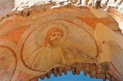 Freskomålning av ett helgon i den tidiga kristen Arkivbilder