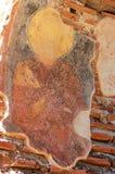 Freskomålning av ett helgon i den tidiga kristna kyrkan Arkivfoton