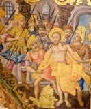 Freskom?lning i kyrkan av den heliga griften, Jerusalem - Jesus rev av av hans kl?der p? l?ngfredag arkivbild