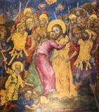 Freskom?lning av judas som f?rr?der Jesus med en kyss i kyrkan av den heliga griften, Jerusalem royaltyfria foton