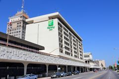 FRESNO, UNITED STATES - APRIL 12, 2014: Holiday Inn hotel in Fresno, California. Holiday Inn is a part of InterContinental Hotels. Group and has 3,414 locations stock image