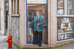 Fresque des Lyonnais : Bernard Pivot and a library Stock Photo