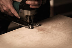 Fret saw. Photo of a man working with fret saw Royalty Free Stock Image