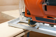 Fret-saw with saw. Electric fret-saw with saw and board Royalty Free Stock Photo