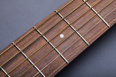 Fretboard on Acoustic Guitar Close-Up on Fifth Fret Stock Photo