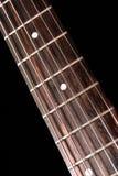 Fretboard de la guitarra eléctrica imagenes de archivo