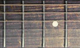 Fretboard della chitarra acustica Fotografie Stock