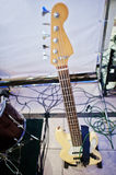 Fretboard of electric bass guitar on stage.  Stock Photo