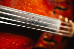 Fretboard with string of old shabby cello Stock Photos