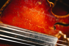 Fretboard with string of old shabby cello Stock Photography