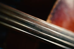 Fretboard with string of old shabby cello Royalty Free Stock Photography