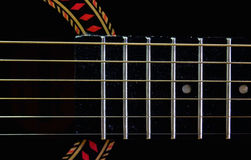 Fretboard and strings on an old guitar Stock Photo