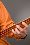 Fretless bass players left hand Royalty Free Stock Image