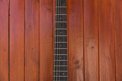 Frets of guitar. On wooden surface royalty free stock photos