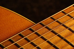 Frets on a neck. A detail of a western guitar Royalty Free Stock Images