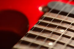 Frets on a neck. Of an electric guitar Stock Photos