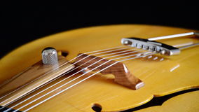 Frets, string, body, mouth and bridge of typical classic spanish guitar rotating in black background. Classic Electric Guitar Jazz Rotating in Horizontal stock video