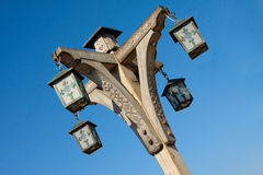 Fretted street lamp. Head of old wooden fretted street lamp Royalty Free Stock Image