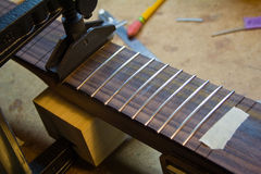 Fretting a guitar Stock Photography