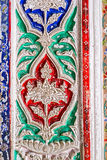 The fretwork on ganch in interior. BUKHARA, UZBEKISTAN - APRIL 29, 2015: The close-up of the tracery fretwork on ganch, painted in different colors in interior Royalty Free Stock Photos