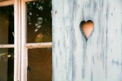 Fretwork heart. Made on wooden shutter Stock Photos