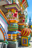 The fretwork pillars in Russian style. The richly decorated porch pillars and sculptures include fretwork and painted details with predominantly floral patterns Royalty Free Stock Photography