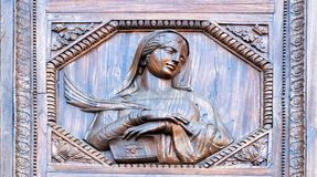 Fretwork young woman. Wood-carving Royalty Free Stock Photos