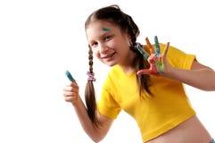 Freude. Jugendliches Mädchen, das mit Farben spielt stockbild