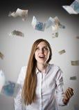 freuen Frau im Weiß und im Euro Stockfoto