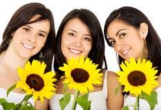 Freunde mit Blumen Stockfotografie