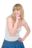 Freundliche Blondine mit einer Hand auf einem Kinn Stockfoto