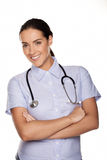 Freundlicher überzeugter Frauenfamiliendoktor stockbild