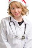 Freundlicher Frauendoktor in einer Sankt Stockbild