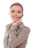 Freundlicher Hilfsliniebediener der jungen Frau im Kopfhörer Lizenzfreies Stockfoto