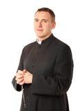 Freundlicher junger Priester Lizenzfreie Stockbilder