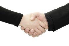 Freundlicher oder Geschäftshändedruck Stockbilder