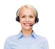 Freundlicher weiblicher Hilfslinienbetreiber mit Kopfhörern Lizenzfreie Stockbilder