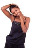 Freundliches Afroamerikanerfrauenlächeln Lizenzfreie Stockfotografie