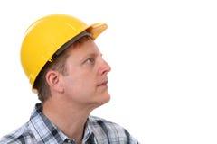 Freundliches Bauarbeiter-Portrait getrennt Stockfotos