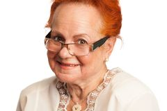 Freundliches Lächeln der alten Dame Lizenzfreie Stockfotos