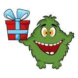 Freundliches Monster, das eine Geschenkbox hält. Lizenzfreie Stockfotos