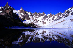 The Frey, Barriloche - Argentina. The Frey Mountain range, Argentina. Semi-frozen lake, reflection in water Royalty Free Stock Photography