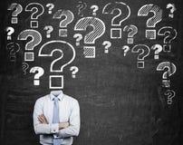 Frågefläck i stället för huvudet Arkivbild