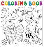 Färgläggningbok med fjärilen och biet Arkivfoto