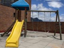 Färgrik barnlekplatsutrustning Fotografering för Bildbyråer