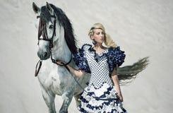Färgrik bild av damen med hästen Arkivfoto
