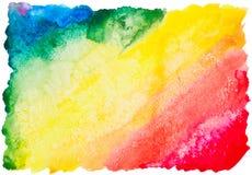 Färgrik vattenfärgregnbågebakgrund Arkivbild